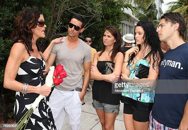 Model Janice Dickinson speaks to models during an appearance at the Versace mansion during taping for her upcoming reality TV show on September 24...