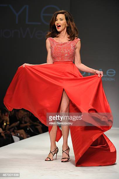 Model Janice Dickinson walks the runway at the Celebrity Red Dress Fashion Show benefitting The American Heart Association at The Reef on March 19,...