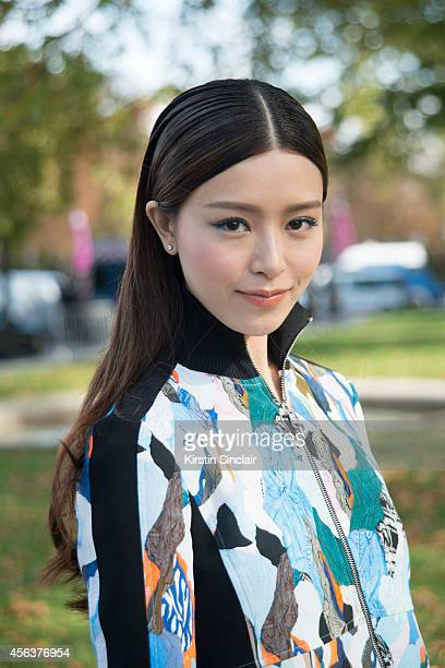 Model Janice Man is wearing a Carven top on September 25 2014 in Paris France