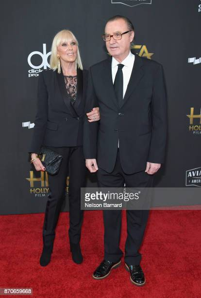 Model Janice Pennington and Hollywood Film Awards founder Carlos de Abreu attend the 21st Annual Hollywood Film Awards at The Beverly Hilton Hotel on...