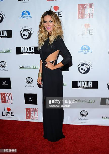 Model Jasmine Dustin arrives at the No Kill LA Charity Event at Fred Segal on April 2 2013 in West Hollywood California