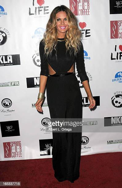 Model Jasmine Dustin hosts for the No Kill LA Charity Event held at Fred Segal on April 2 2013 in West Hollywood California