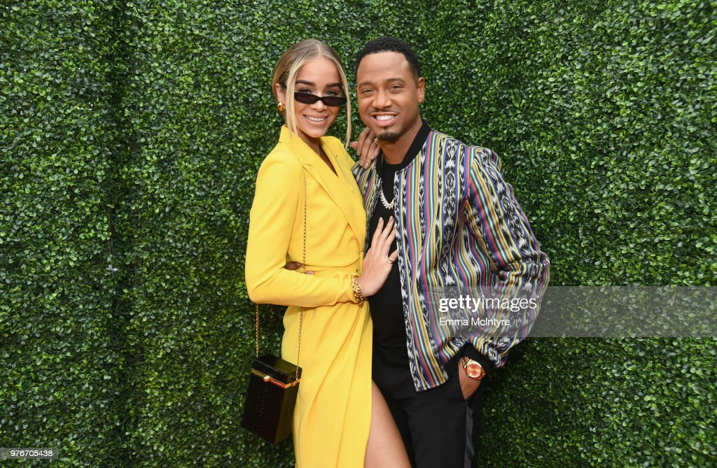 Model Jasmine Sanders (L) and actor Terrence J attend the 2018 MTV Movie And TV Awards at Barker Hangar on June 16, 2018 in Santa Monica, California.