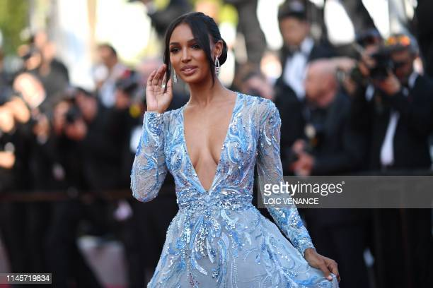 US model Jasmine Tookes poses as she arrives for the screening of the film The Traitor at the 72nd edition of the Cannes Film Festival in Cannes...
