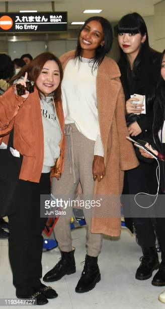 Model Jasmine Tookes poses for a photograph with the fan upon arrival at Narita International Airport on January 13 2020 in Narita Japan