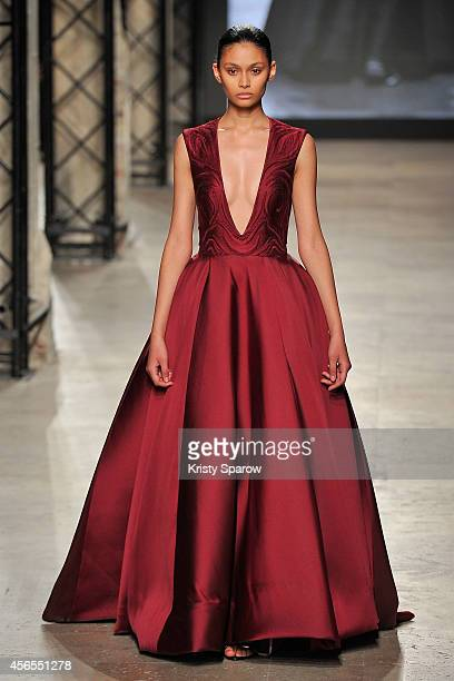 Model Jasmine walks the runway during the Elite Model Look 2014 France series at Palais de Tokyo on October 2 2014 in Paris France
