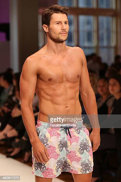 Model Jason Dundas showcases designs by The Rocks Push during a rehearsal ahead of the David Jones Spring/Summer 2014 Collection Launch at David...