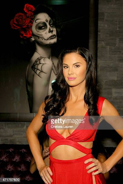 Model Jayde Nicole poses in front of her portrait during EDL's grand opening party for Toca Madera on April 30 2015 in Los Angeles California
