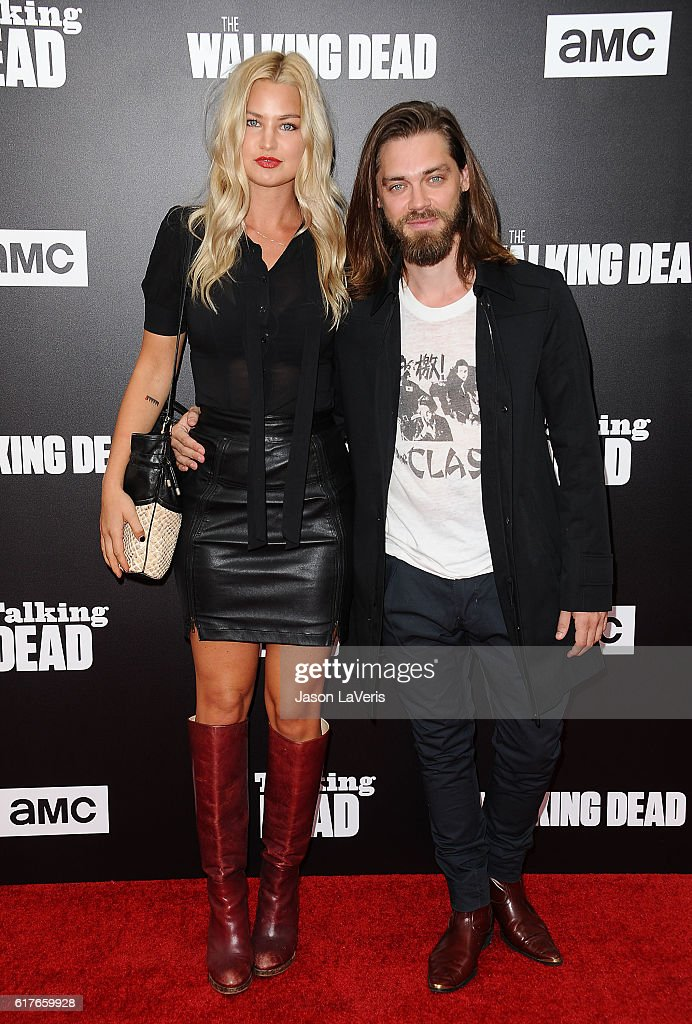 Model Jennifer Akerman and actor Tom Payne attend the live, 90-minute special edition of 'Talking Dead' at Hollywood Forever on October 23, 2016 in Hollywood, California.