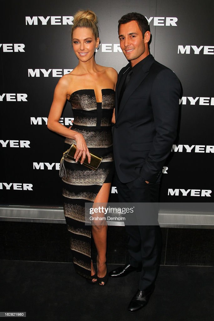 Model Jennifer Hawkins (L) and Jake Wall arrive at the Myer Autumn/Winter 2013 collections launch at Mural Hall at Myer on February 28, 2013 in Melbourne, Australia.