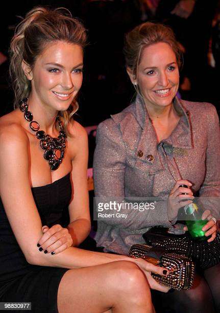 Model Jennifer Hawkins and media personality Fifi Box attend the front row of the Nicola Finetti collection show on the second day of Rosemount...