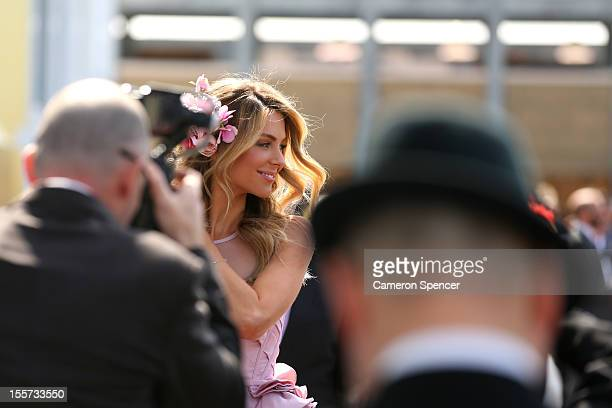 Model Jennifer Hawkins poses in the birdcage enclosure on Crown Oaks Day at Flemington Racecourse on November 8 2012 in Melbourne Australia