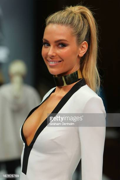 Model Jennifer Hawkins showcases designs by Arthur Galan at the Myer Autumn/Winter 2013 collections launch at Mural Hall at Myer on February 28 2013...