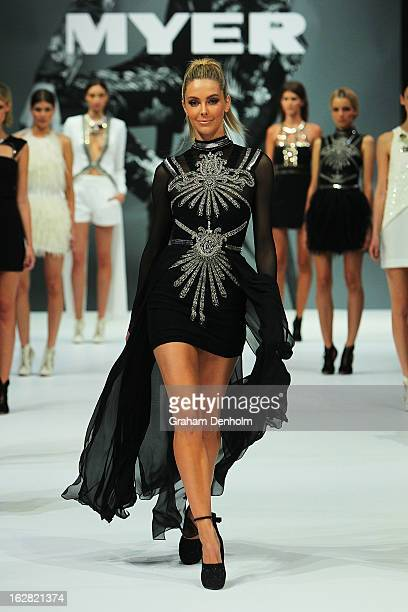 Model Jennifer Hawkins showcases designs by Sass Bide at the Myer Autumn/Winter 2013 collections launch at Mural Hall at Myer on February 28 2013 in...