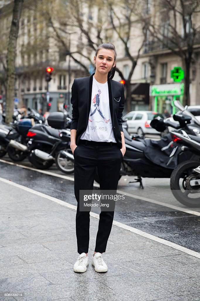 Model Jenny Albright wears a slim black Kooples suit with a Richard Haines illustration t-shirt on January 23, 2016 in Paris, France.