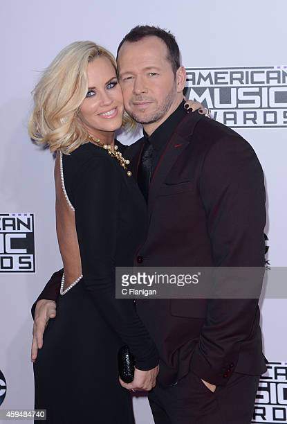 Model Jenny McCarthy and actor Donnie Wahlberg attend the 42nd Annual American Music Awards at Nokia Theatre LA Live on November 23 2014 in Los...