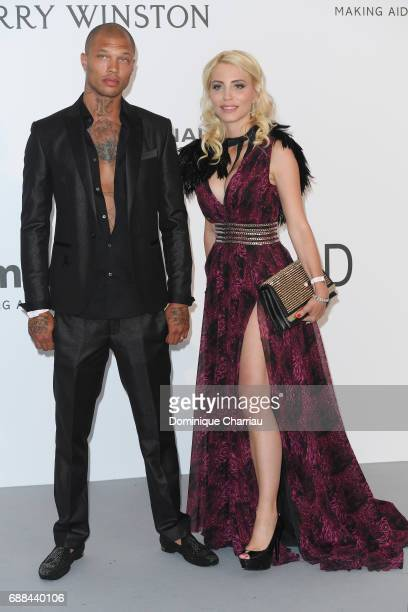 Model Jeremy Meeks and guest arrive at the amfAR Gala Cannes 2017 at Hotel du CapEdenRoc on May 25 2017 in Cap d'Antibes France