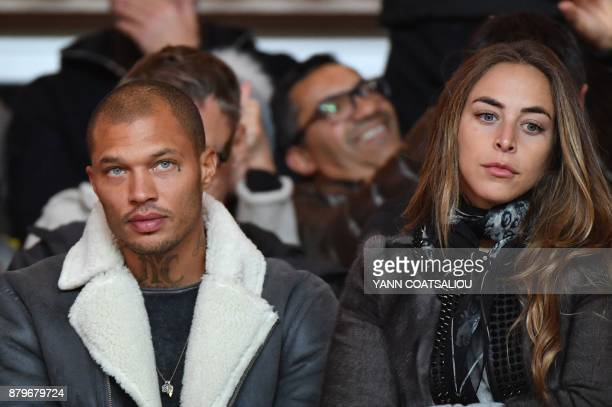 US model Jeremy Meeks and his companion British heiress Chloe Green look on prior to the French L1 football match between Monaco and Paris...