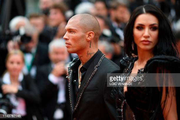 US model Jeremy Meeks and model Andreea Sasu arrive for the screening of the film The Dead Don't Die during the 72nd edition of the Cannes Film...