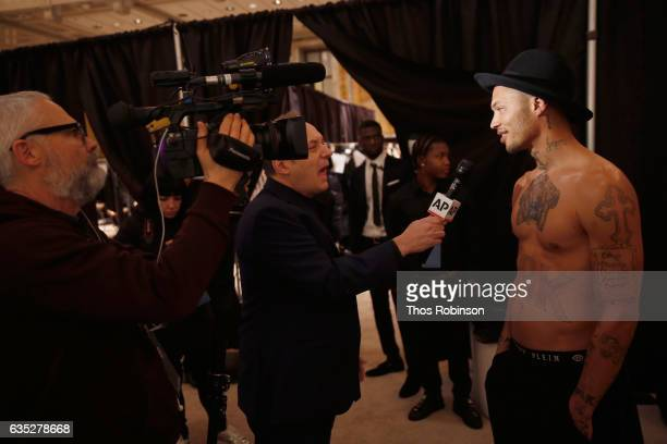 Model Jeremy Meeks gives and interview backstage for the Philipp Plein Fall/Winter 2017/2018 Women's And Men's Fashion Show at The New York Public...