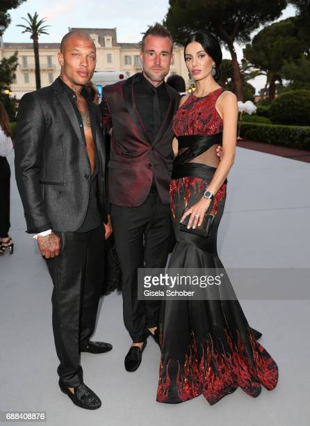 Model Jeremy Meeks Philipp Plein and Andreea Sasu arrive at the amfAR Gala Cannes 2017 at Hotel du CapEdenRoc on May 25 2017 in Cap d'Antibes France