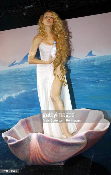 Model Jerry Hall launches 'Heaven by Evian' in the window of Selfridges department store in central London Jerry was recreating Botticelli's 'The...