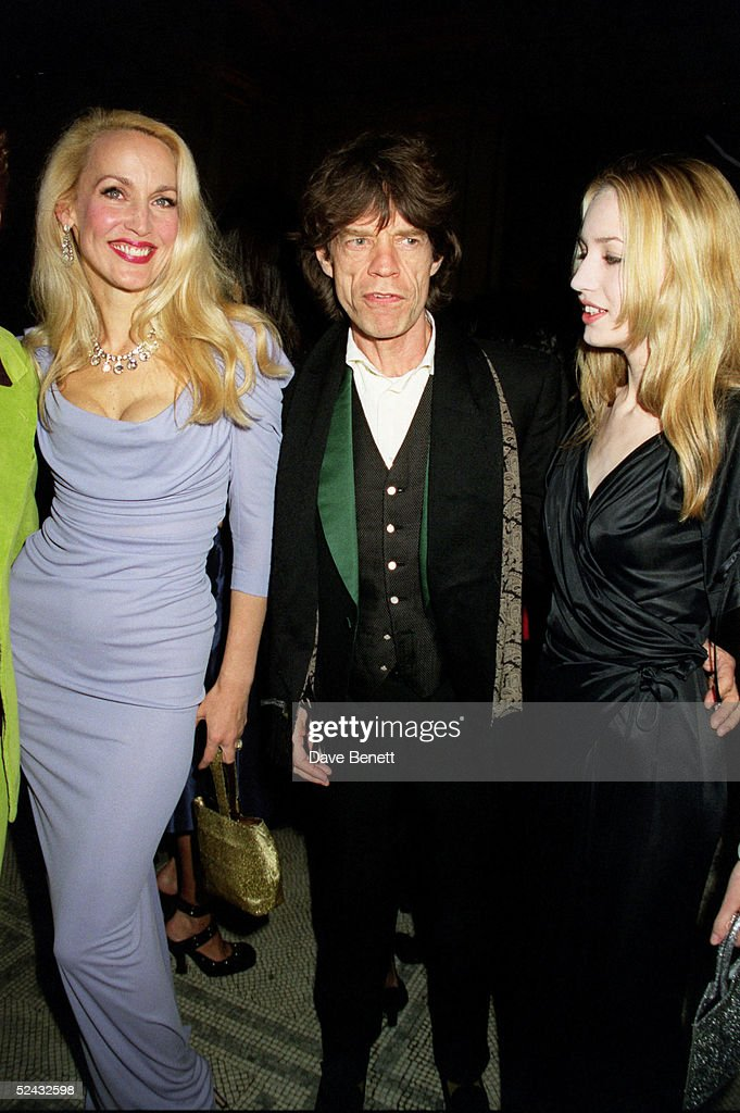 Model Jerry Hall, Rolling Stones singer Mick Jagger and his daughter Elizabeth Jagger at the Moet and Chandon Fashion Tribute for Vivienne Westwood who has profoundly influenced Great Britain?s Lifestyle, held at the V & A Museum on February 01, 2001 in London. (Photo by Dave Benett/Getty Images).