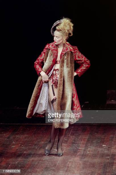 US model Jerry Hall shows what's under her long tapestrylike coat with furry collar and quilted lining on March 14 1997 in Paris during the 1997/98...