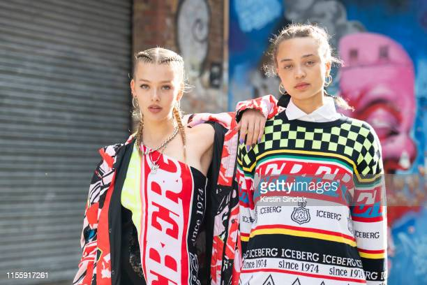 Model Jess Alexander wears all Iceberg with Singer Connie Constance wearing all Iceberg during London Fashion Week Men's June 2019 on June 08 2019 in...