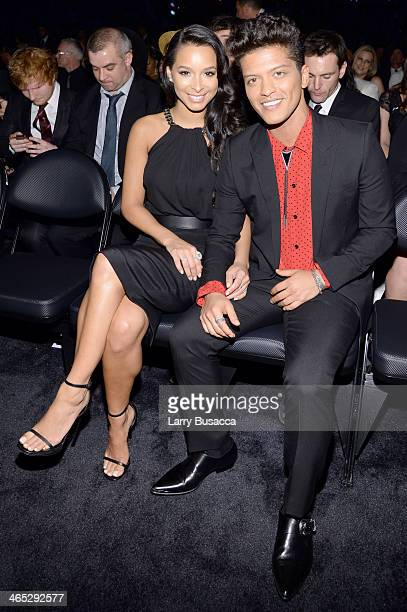 Model Jessica Caban and recording artist Bruno Mars attend the 56th GRAMMY Awards at Staples Center on January 26 2014 in Los Angeles California