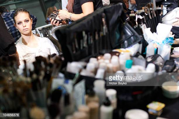 Model Jessica Clarke prepares backstage before the Lanvin Ready to Wear Spring/Summer 2011 show during Paris Fashion Week at Halle Freyssinet on...