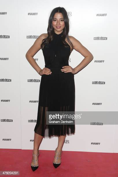 Model Jessica Gomes poses as she arrives for the 2014 Virgin Australia Melbourne Fashion Festival Opening Event presented by David Jones at Docklands...