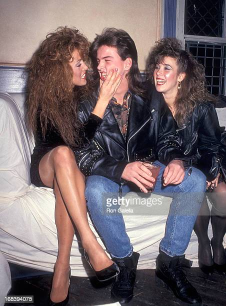 Model Jessica Hahn halfbrother Danny Moylan and his girlfriend attend Jessica Hahn's Chanukah Party on December 11 1990 at the Limelight in New York...