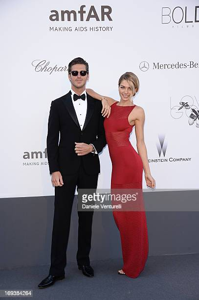 Model Jessica Hart and guest attends amfAR's 20th Annual Cinema Against AIDS during The 66th Annual Cannes Film Festival at Hotel du CapEdenRoc on...