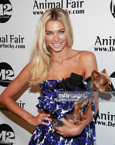 Model Jessica Hart and her dog Charlie attend Animal Fair's 10th Annual Paws For Style at M2 Ultra Lounge on July 27 2009 in New York City