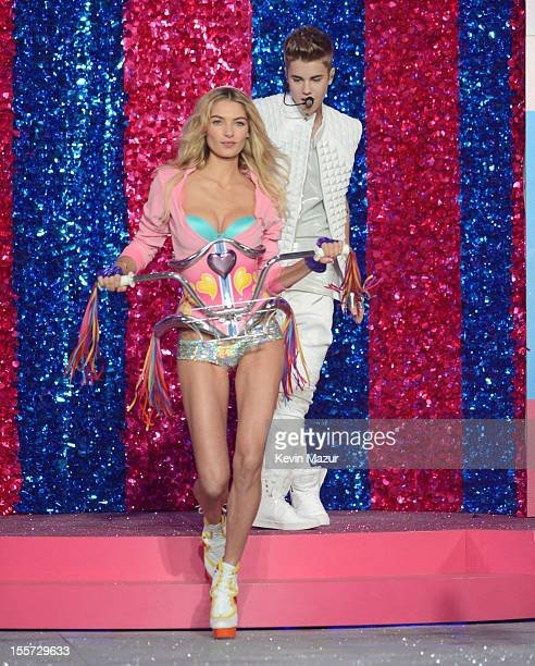 Model Jessica Hart and singer Justin Bieber on stage during the 2012 Victoria's Secret Fashion Show at the Lexington Avenue Armory on November 7 2012...