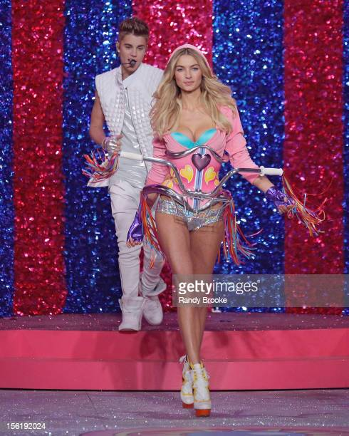 Model Jessica Hart is checked out by Justin Bieber as he performs during the 2012 Victoria's Secret Fashion Show at the Lexington Avenue Armory on...