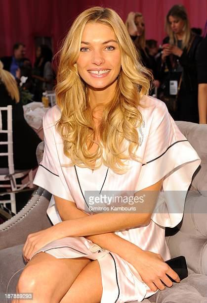 Model Jessica Hart prepares at the 2013 Victoria's Secret Fashion Show hair and makeup room at Lexington Avenue Armory on November 13 2013 in New...