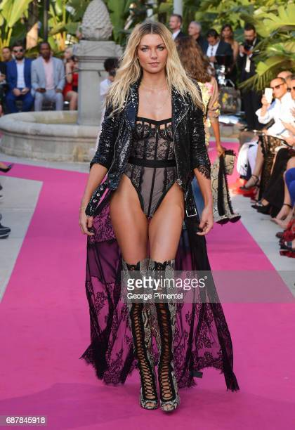 Model Jessica Hart wearing Philipp Plein walk the runway at the Philipp Plein Cruise Show 2018 during the 70th annual Cannes Film Festival at on May...