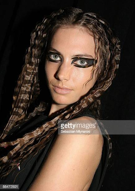 Model Jessica Miller poses backstage at the Jeremy Scott Spring 2006 fashion show during Olympus Fashion Week at the Altman Building on September 14...