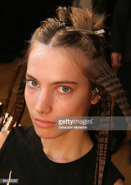 Model Jessica Miller prepares backstage at the Jeremy Scott Spring 2006 fashion show during Olympus Fashion Week at the Altman Building on September...