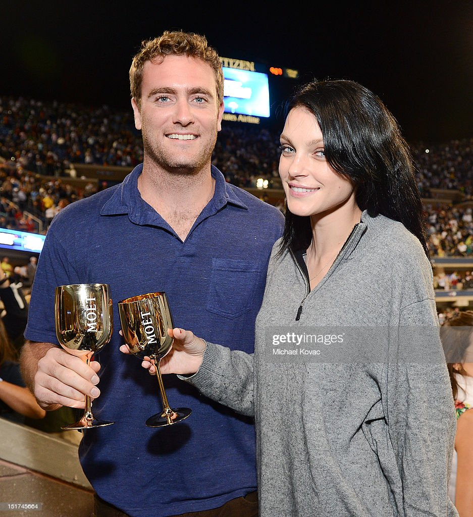 Model Jessica Stam (R) and Charlie Wiggins visit the Moet & Chandon Suite at the 2012 US Open at the USTA Billie Jean King National Tennis Center on September 10, 2012 in the Flushing neighborhood of the Queens borough of New York City.