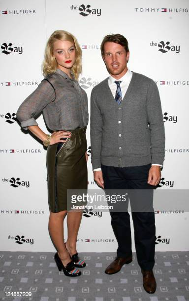 Model Jessica Stam and hockey player Brad Richards arrive at Tommy Hilfiger Launches Menswear at The Bay at The Bay on September 13, 2011 in Toronto,...