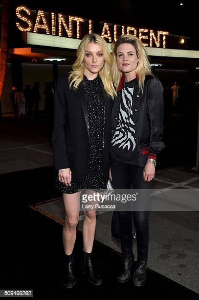Model Jessica Stam and musician Alison Mosshart attend Saint Laurent at the Palladium on February 10 2016 in Los Angeles California for the Saint...