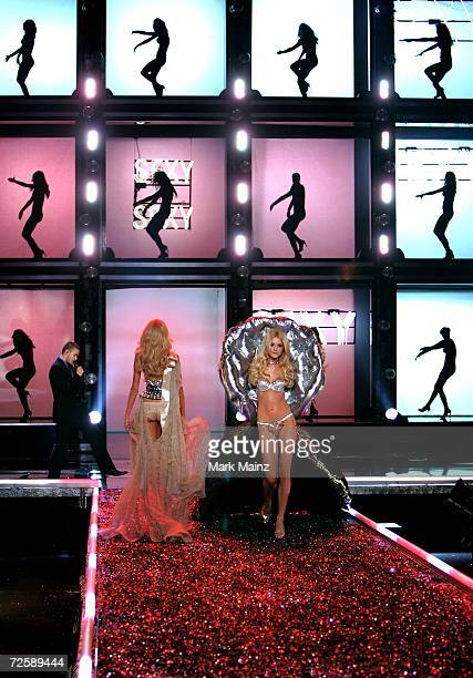 Model Jessica Stam walks the runway as singer Justin Timberlake performs during the Victoria's Secret Fashion Show held at the Kodak Theatre on...