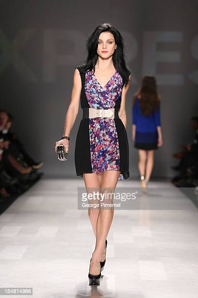 Model Jessica Stam walks the runway wearing Express spring 2013 collection at David Pecaut Square on October 26 2012 in Toronto Canada