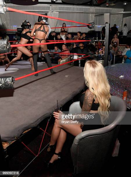 "Model Jessica Weaver judges contestants competing in ""Foxy Boxing"" as she hosts Larry Flynt's Hustler Club Instagram party at Larry Flynt's Hustler..."