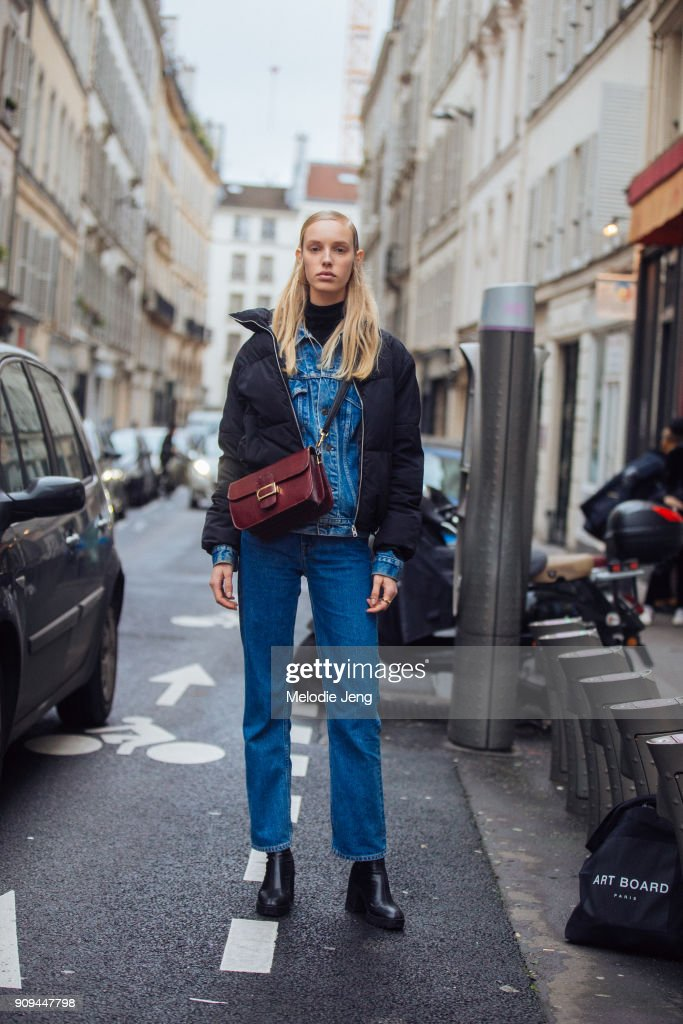 Model Jessie Bloemendaal wears a black puffer jacket over a denim jacket and jeans outside the Ellery show at Ecole des Beaux-Arts on January 23, 2018 in Paris, France.