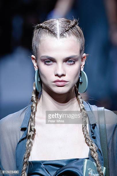 A model jewel detail walks the runway during the Emporio Armani show as part of the Paris Fashion Week Womenswear Spring/Summer 2017 on October 3...