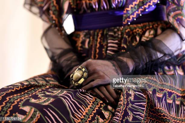 A model jewelry detail poses at the Zandra Rhodes Presentation during London Fashion Week February 2019 on February 19 2019 in London England